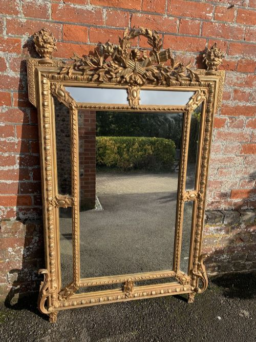 a spectacular large antique french 19th century carved wood gesso original gilt cushion mirror
