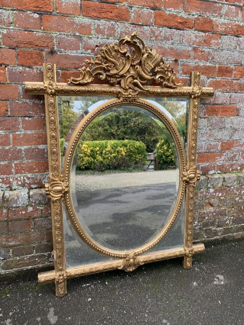 a delightful good size antique french 19th century carved wood gesso original gilt sectioned oval cross framed mirror