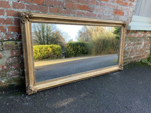 a stunning large antique french 19th century carved wood and gesso original distressed gilt mirror