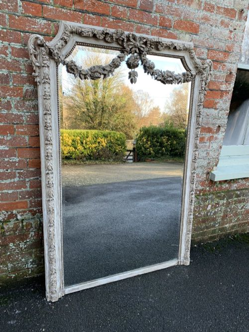 an absolutely stunning large antique french 19th century carved wood gesso shaped top painted mirror