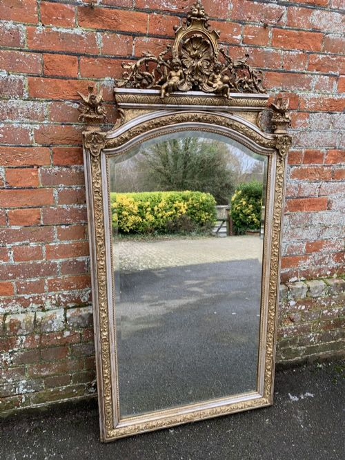 a fabulous large antique french 19th century carved wood gesso original silvergilt shaped top mirror