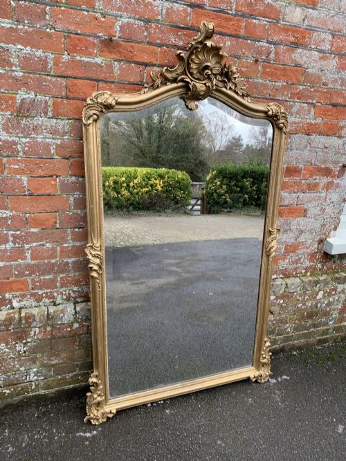 a stunning large antique french 19th century carved wood and gesso original gilt shaped top mirror