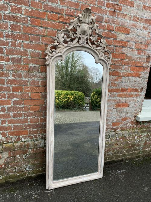 a delightful large antique shaped top french 19th century carved wood painted mirror