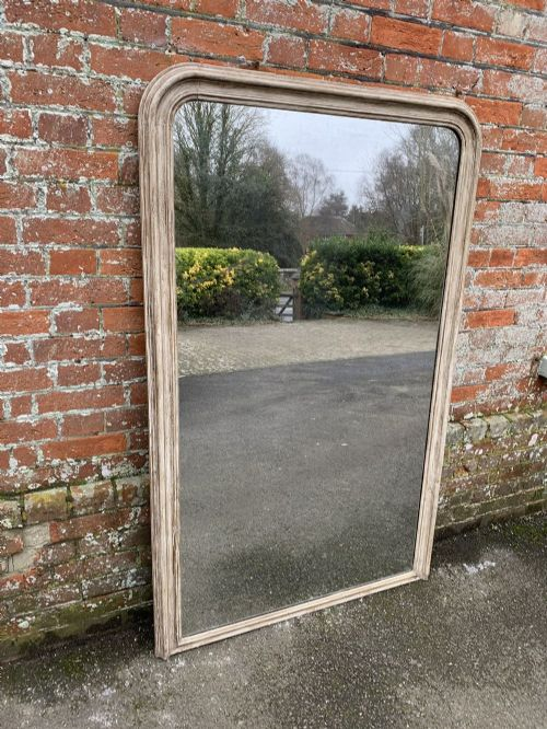 a fabulous large antique french 19th century carved wood and gesso arched top painted mirror