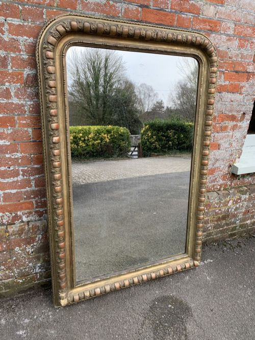 a wonderful large antique large french 19th century carved wood gesso arched top original gilt mirror