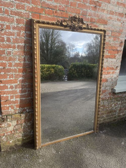 a spectacular large antique french 19th century carved wood and gesso original gilt mirror