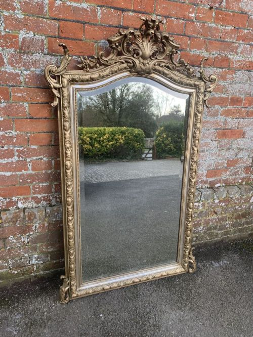 a delightful large antique french 19th century carved wood and gesso shaped top original silvergilt mirror