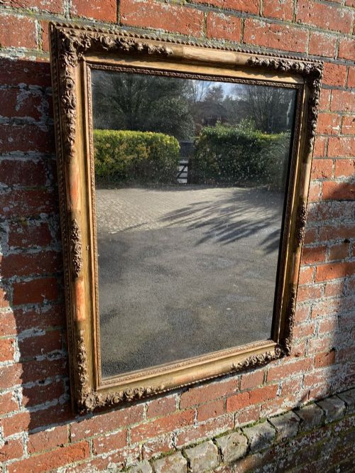 a highly useful size early antique french 19th century carved wood and gesso original gilt flowered framed louis philippe mirror