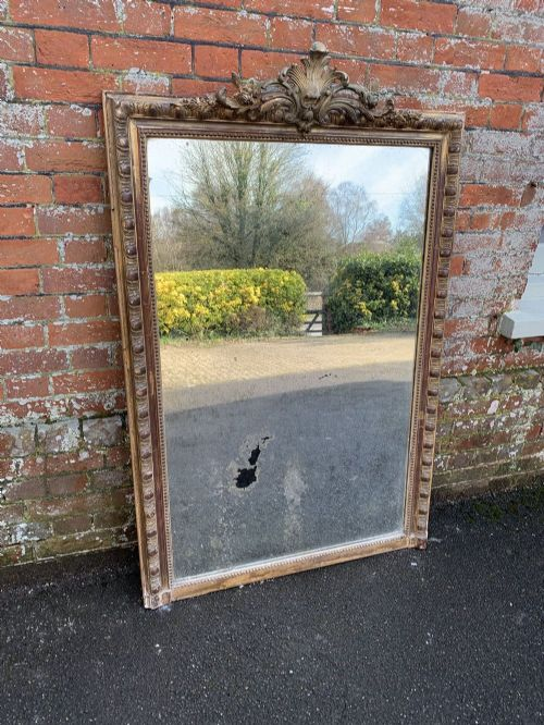 a delightful large antique french 19th century carved wood and gesso original gilt mirror