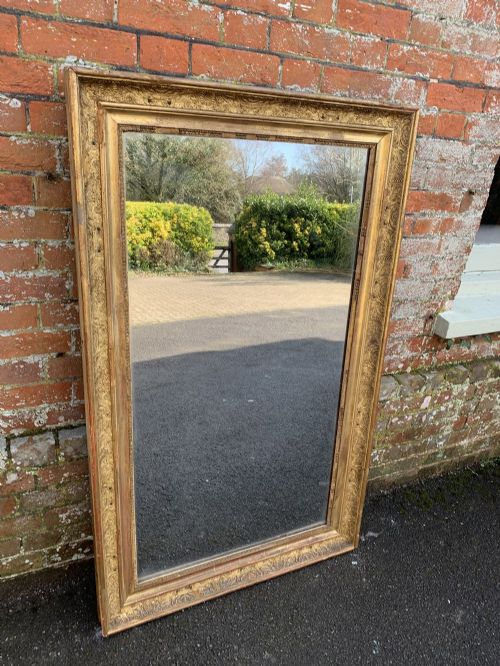 a stunning large antique french 19th century carved wood and gesso original gilt detailed framed mirror