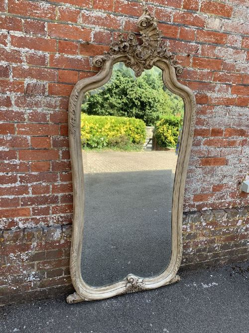 a stunning large antique french 19th century carved wood shaped top painted mirror