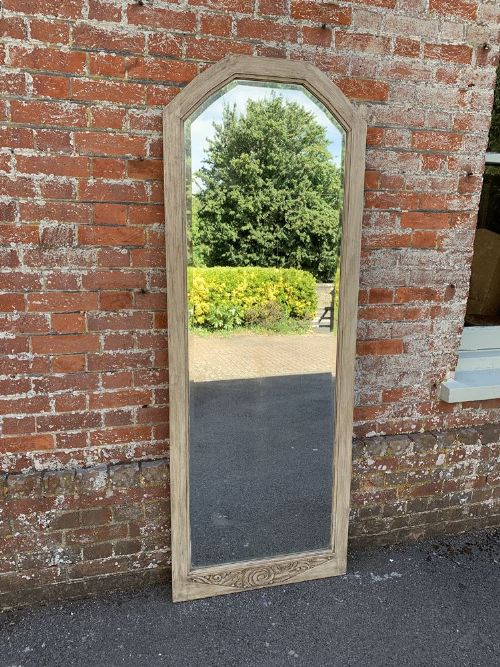 a delightful large antique french 19th century carved wood painted shaped top plain mirror