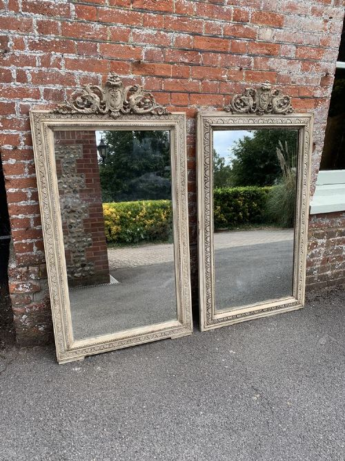 a spectacular near pair of antique french 19th century carved wood gesso painted mirrors
