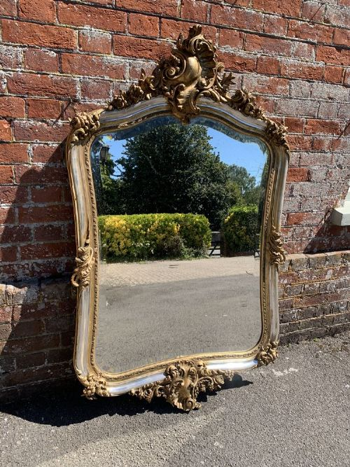 a superb large antique french 19th century carved wood gesso original silvergilt shaped mirror