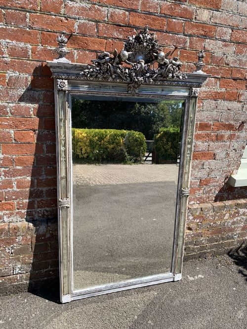 a spectacular large antique french 19th century carved wood gesso original silvered and painted mirror