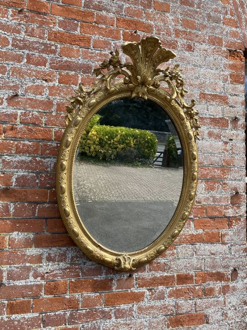 a spectacular good size antique french 19th century carved wood gesso original gilt oval mirror