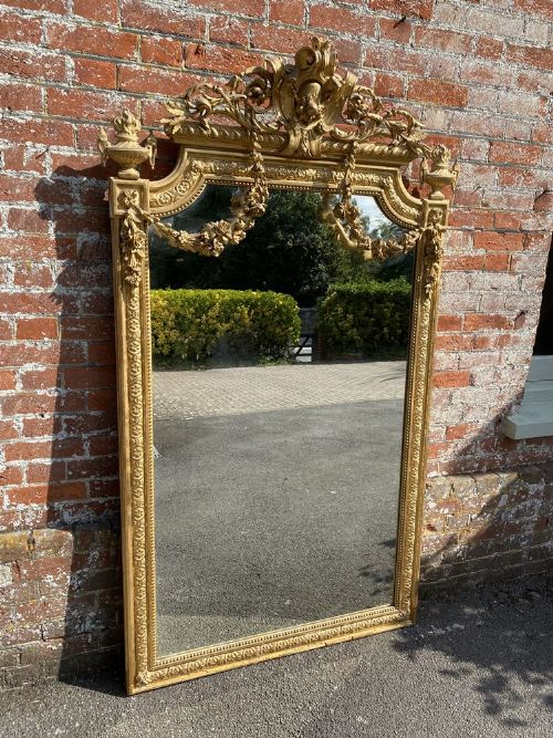 a sensational large antique french 19th century carved wood gesso shaped top original gilt mirror