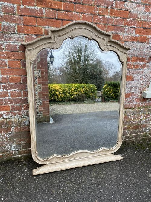 a superb highly unusual large antique french 19th century carved wood painted shaped top mirror