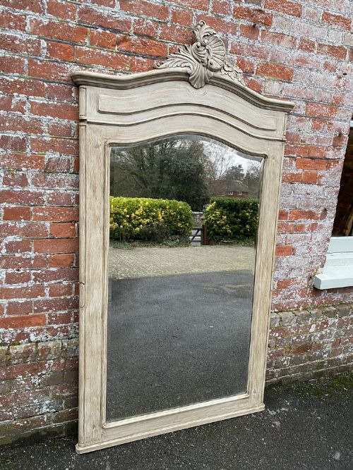 a delightful large antique french 19th century carved wood painted shaped top mirror
