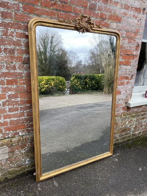 an exceptional large antique french 19th century carved wood gesso arched top original gilt mirror