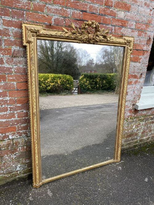 a superb large antique french 19th century carved wood gesso original gilt shaped top mirror