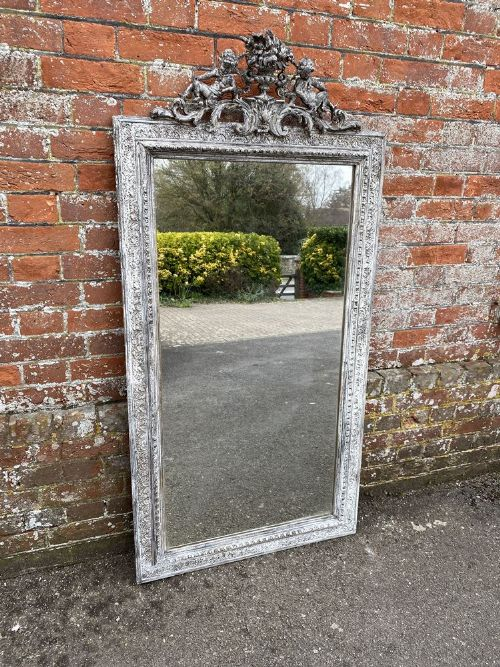 a delightful large antique french 19th century carved wood gesso painted mirror