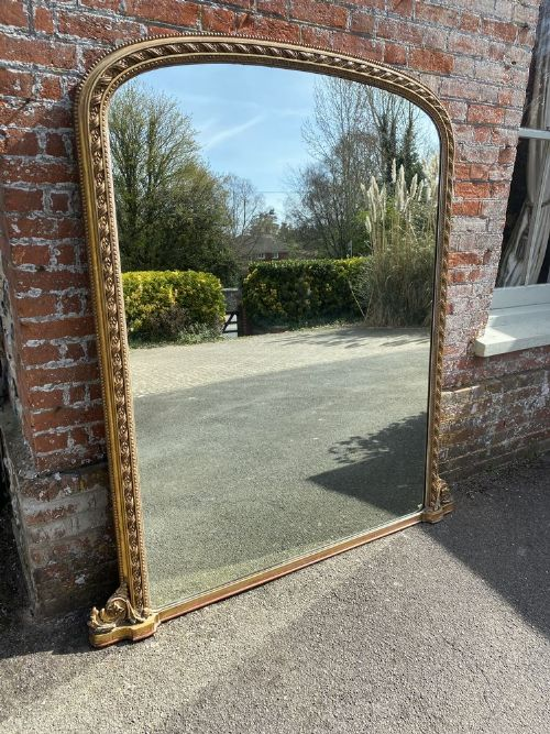 a spectacular large antique english 19th century carved wood gesso original gilt arched top overmantle mirror