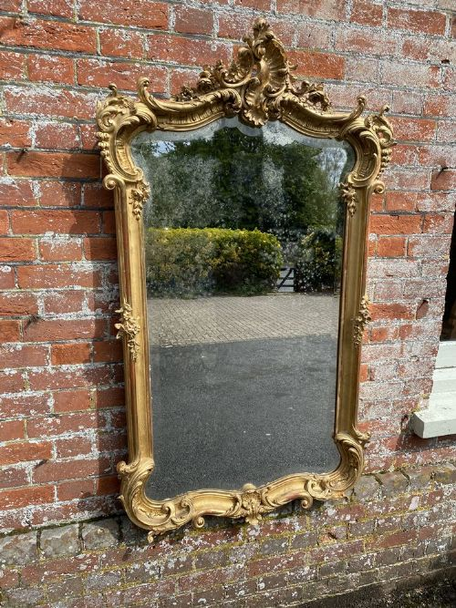 an exceptional large antique french 19th century carved wood gesso original gilt shaped top mirror