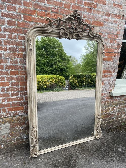 a spectacular large antique french 19th century carved wood gesso arched top painted mirror