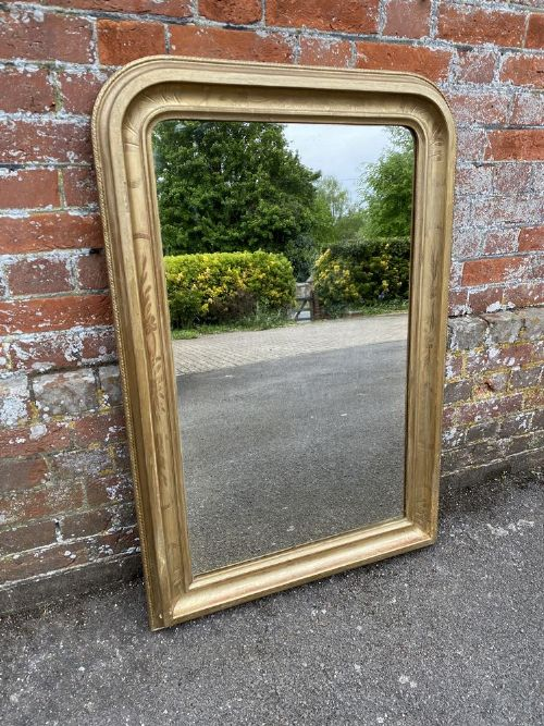 a stunning good size antique french 19th century carved wood gesso original gilt arched top mirror