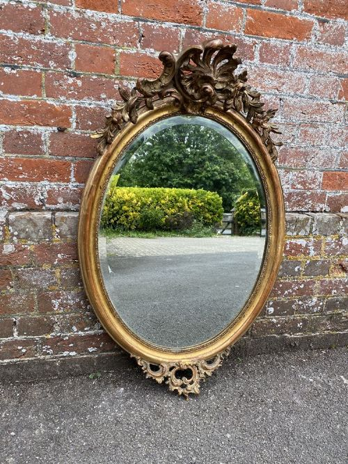 a superb antique french 19th century carved wood gesso original gilt oval mirror