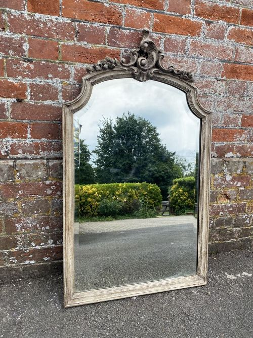 a superb antique french 19th century carved wood gesso painted shaped top mirror
