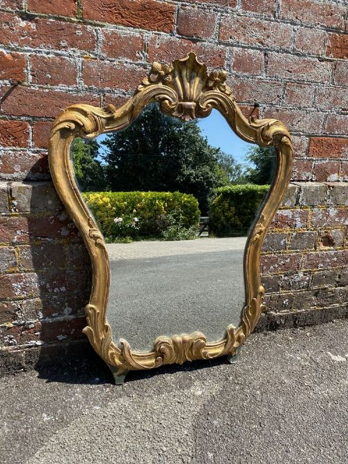 a stunning good size antique french 19th century carved wood gesso original gilt shaped mirror