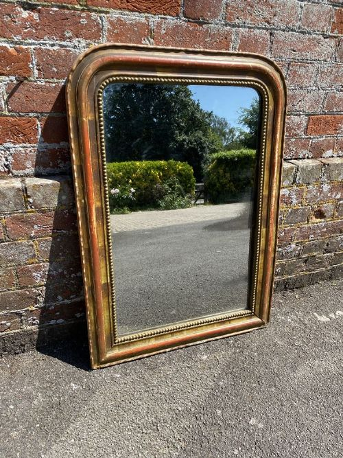 a spectacular useful size antique french 19th century carved wood gesso original gilt ribbed arched mirror