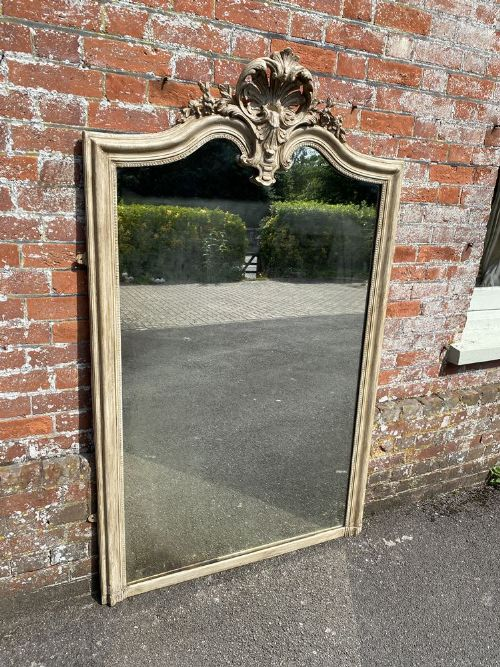 a delightful large antique french 19th century carved wood gesso shaped top painted mirror