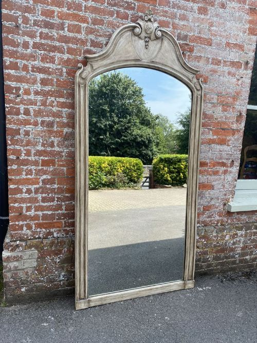 a spectacular large antique french 19th century carved wood painted shaped top mirror