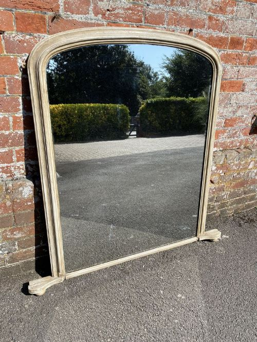 a delightful large antique english 19th century carved wood gesso painted arched top mirror