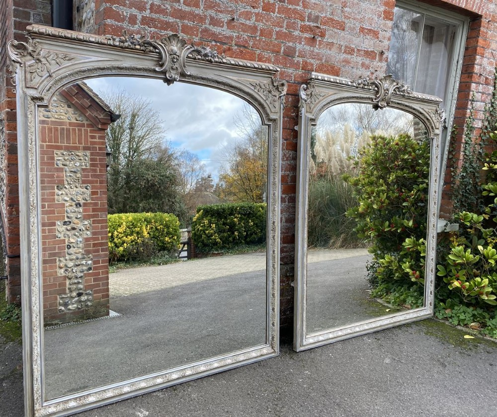 an absolutely stunning highly unusual pair of large antique french 19th century original silvered and painted shaped top mirrors
