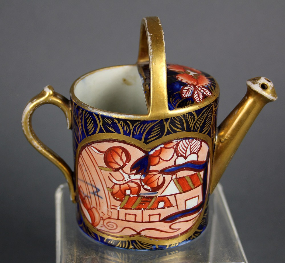 a mason's ironstone miniature watering can