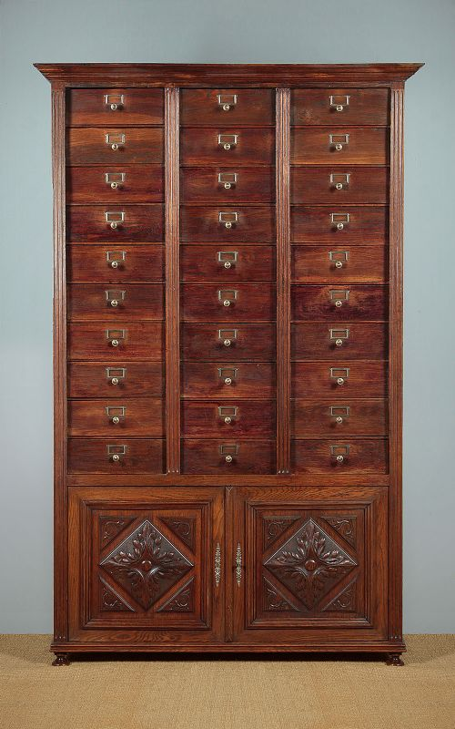 tall oak bank of drawers c1900