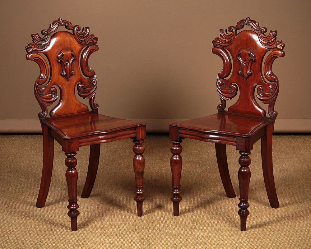 pair mid 19thc mahogany hall chairs c1860