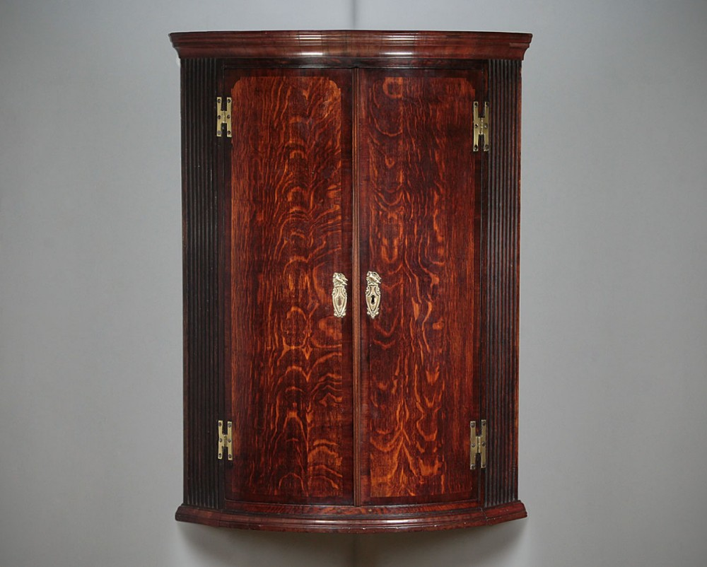 oak mahogany bow front corner cupboard c1800