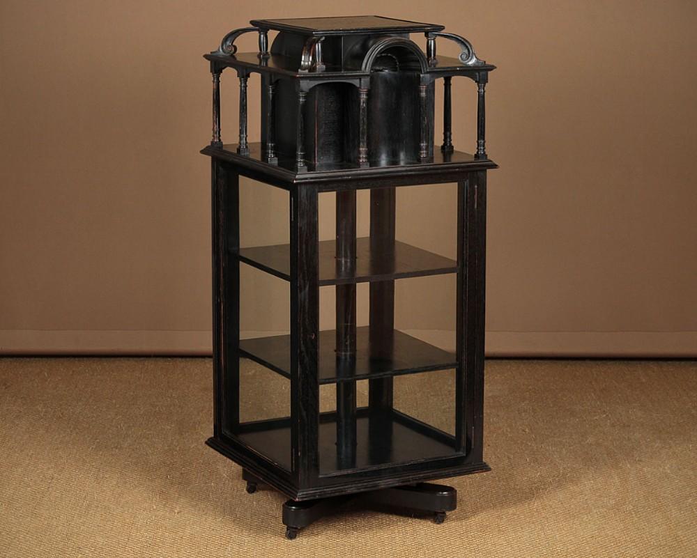 ebonised revolving bijouterie display cabinet c1880