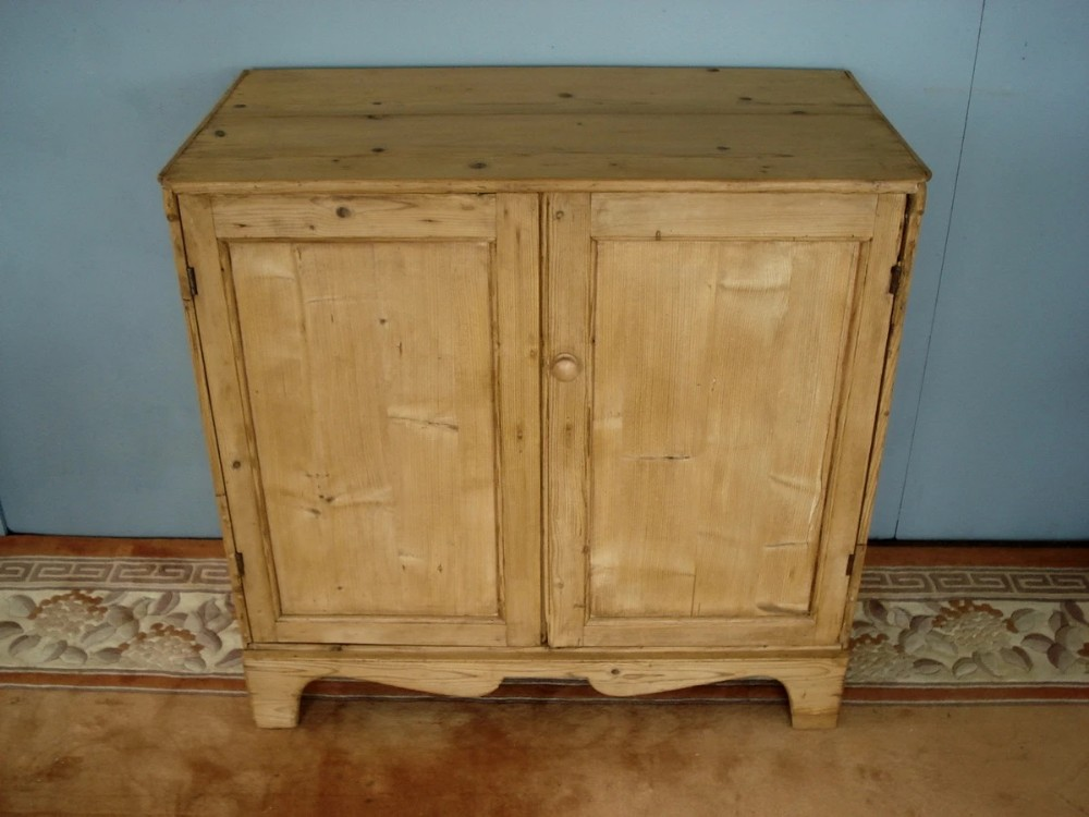 country early 19th century two door pine cupboard