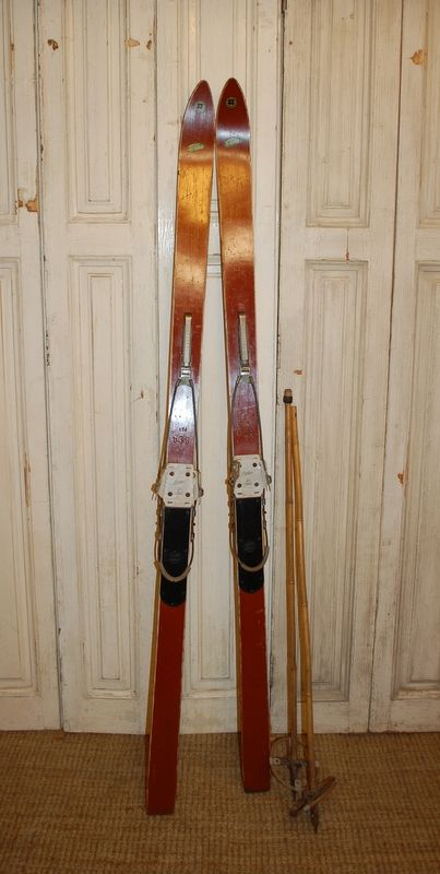 antique set of german skis with poles