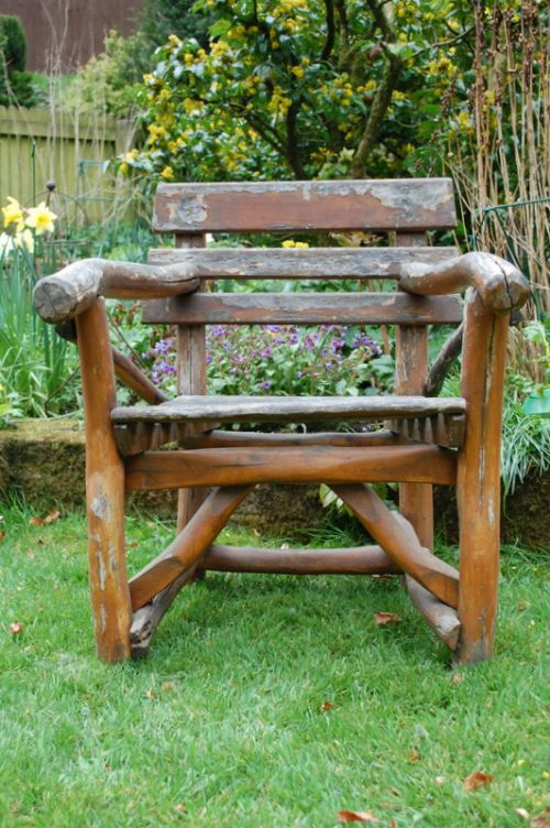 antique rustic wooden swiss garden arm chair