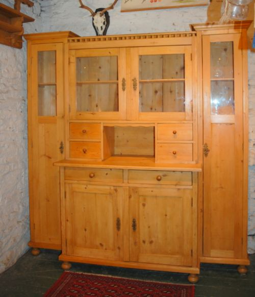antique large continental pine kitchen dresser with later added side cabinets and spice drawers 1920