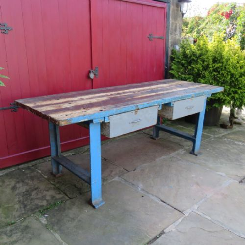 large vintage industrial cast iron work table with hung drawers dismantles