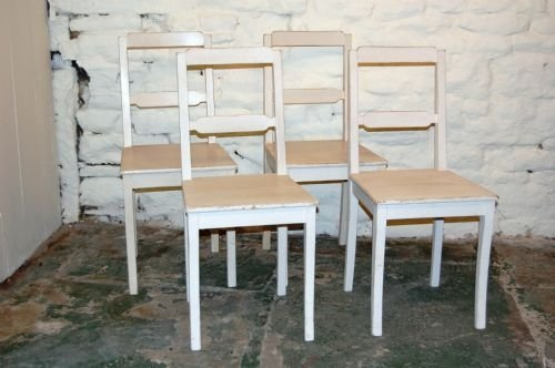 set of four painted pine chairs