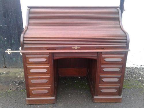 a large victorian mahogany rolltop desk